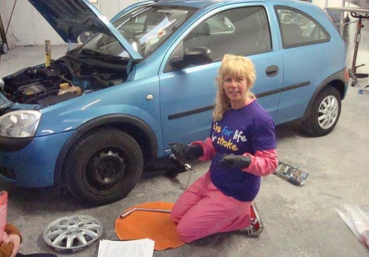 Lisa Bailies Auto Refinishers Changing Tyre